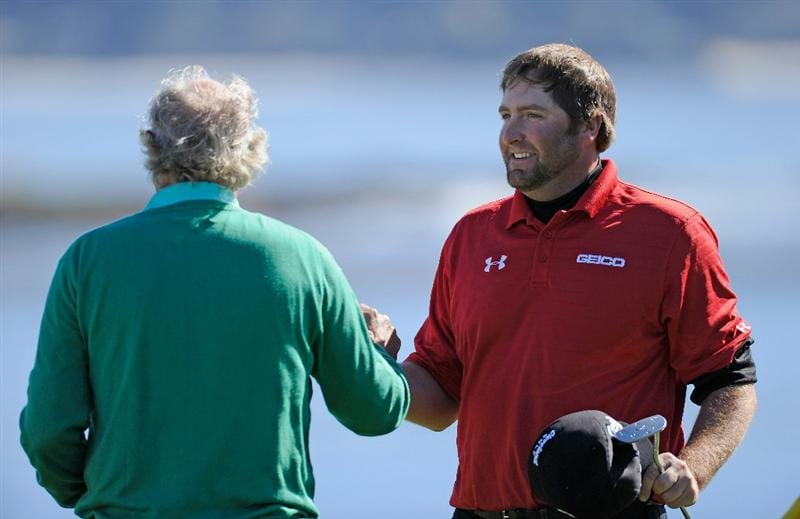 PEBBLE BEACH, CA - FEBRUARY 11:  Steve Marino celebrates with his playing partner  Dermot Desmond of Ireland on the 18th during the second round of the AT&T Pebble Beach National Pro-Am at the Pebble Beach Golf Links on February 11, 2011  in Pebble Beach, California  (Photo by Stuart Franklin/Getty Images)