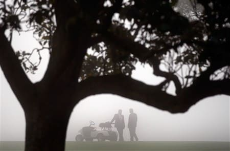 AUGUSTA, GA - APRIL 10:  Officials wait near the first hole after play was delayed by fog during the first round of the 2008 Masters Tournament at Augusta National Golf Club on April 10, 2008 in Augusta, Georgia.  (Photo by Jamie Squire/Getty Images)
