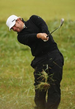 CARNOUSTIE, UNITED KINGDOM - JULY 19:  Ryan Moore of USA hits a shot from the rough on the second hole during the first round of The 136th Open Championship at the Carnoustie Golf Club on July 19, 2007 in Carnoustie, Scotland.  (Photo by Ross Kinnaird/Getty Images)