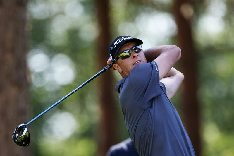 VIRGINIA WATER, ENGLAND - MAY 23:  Fredrik Andersson Hed of Sweden tees off at the 11th hole during the final round of the BMW PGA Championship on the West Course at Wentworth on May 23, 2010 in Virginia Water, England.  (Photo by Ross Kinnaird/Getty Images)