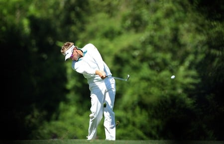 AUGUSTA, GA - APRIL 13:  Ian Poulter of England hits his approach shot on the fifth hole during the final round of the 2008 Masters Tournament at Augusta National Golf Club on April 13, 2008 in Augusta, Georgia.  (Photo by David Cannon/Getty Images)