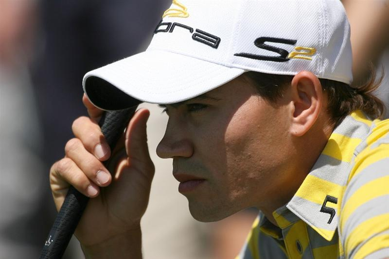 DORAL, FL - MARCH 13:  Camilo Villegas of Colombia lines up a putt on the fourth hole during round three of the 2010 WGC-CA Championship at the TPC Blue Monster at Doral on March 13, 2010 in Doral, Florida.  (Photo by Marc Serota/Getty Images)