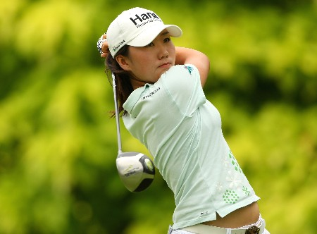 SINGAPORE - MARCH 01:  In-Kyung Kim of South Korea tees off on the sixth hole during the third round of the HSBC Women's Champions at Tanah Merah Country Club on March 1, 2008 in Singapore.  (Photo by Andrew Redington/Getty Images)