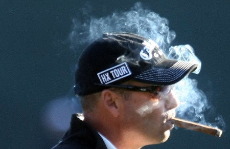 SCOTTSDALE, AZ - FEBRUARY 01:  Rocco Mediate smokes a cigar during the second round of the FBR Open at the TPC Scottsdale on February 1, 2008 in Scottsdale, Arizona.  (Photo by Scott Halleran/Getty Images)