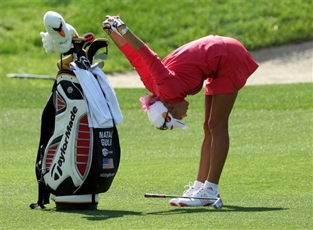 RANCHO MIRAGE, CA - APRIL 04:  Natalie Gulbis of the USA stretches as she prepares to hit her second shot at the 16th hole during the second round of the Kraft Nabisco Championship at the Mission Hills Country Club, on April 4, 2008 in Rancho Mirage, California.  (Photo by David Cannon/Getty Images)