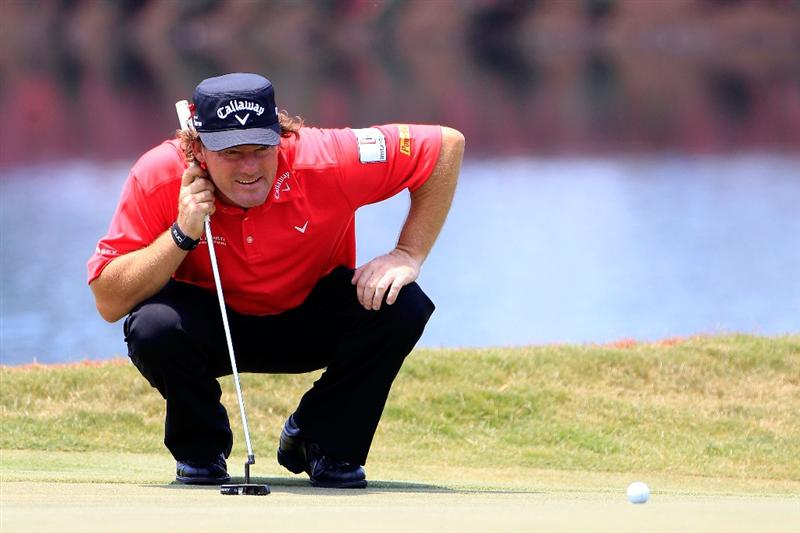 PONTE VEDRA BEACH, FL - MAY 13:  Alex Cejka of Czech Republic lines up a putt during the second round of THE PLAYERS Championship held at THE PLAYERS Stadium course at TPC Sawgrass on May 13, 2011 in Ponte Vedra Beach, Florida.  (Photo by Sam Greenwood/Getty Images)