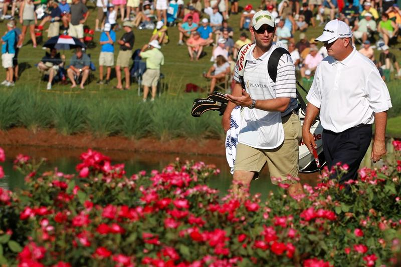 PONTE VEDRA BEACH, FL - MAY 15:  Paul Goydos (R) and caddie Chris Mazziotti (L) walk to the 17th green during the final round of THE PLAYERS Championship held at THE PLAYERS Stadium course at TPC Sawgrass on May 15, 2011 in Ponte Vedra Beach, Florida. Goydos finished with a 3-under-par 69.  (Photo by Scott Halleran/Getty Images)