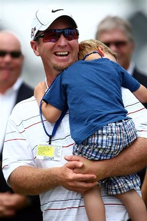 FARMINGDALE, NY - JUNE 22:  David Duval smiles while holding his two year old son Brayden during the trophy presentation after the final round of the 109th U.S. Open on the Black Course at Bethpage State Park on June 22, 2009 in Farmingdale, New York.  (Photo by Chris McGrath/Getty Images)