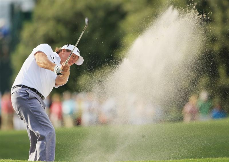 CHARLOTTE, NC - MAY 07:  Phil Mickelson plays a shot from a fairway bunker on the 16th hole during the third round of the Wells Fargo Championship at Quail Hollow Club on May 7, 2011 in Charlotte, North Carolina.  (Photo by Streeter Lecka/Getty Images)