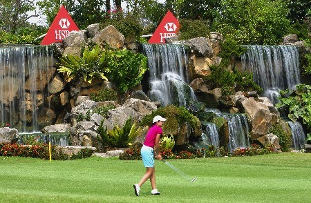 SINGAPORE - FEBRUARY 28:  Lorena Ochoa of Mexico hits her second shot on the 18th hole during the first round of the HSBC Women's Champions at Tanah Merah Country Club on February 28, 2008 in Singapore.  (Photo by Andrew Redington/Getty Images)