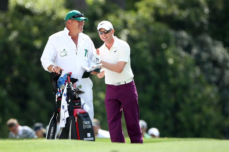 AUGUSTA, GA - APRIL 08:  Simon Dyson of England (R) talks with his caddie Guy Tilston on the first hole during the first round of the 2010 Masters Tournament at Augusta National Golf Club on April 8, 2010 in Augusta, Georgia.  (Photo by Andrew Redington/Getty Images)