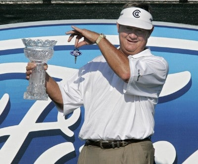 Bobby Wadkins holds up the trophy and key to a new Ford after winning the Ford Senior Players Championship held at TPC Michigan in Dearborn, Michigan, on July 16, 2006.Photo by Gregory Shamus/WireImage.com