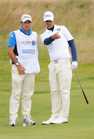TURNBERRY, SCOTLAND - JULY 18:  Matteo Manassero (R) (Amateur) of Italy discusses a shot with caddy Alberto Binagh during round three of the 138th Open Championship on the Ailsa Course, Turnberry Golf Club on July 18, 2009 in Turnberry, Scotland.  (Photo by Harry How/Getty Images)