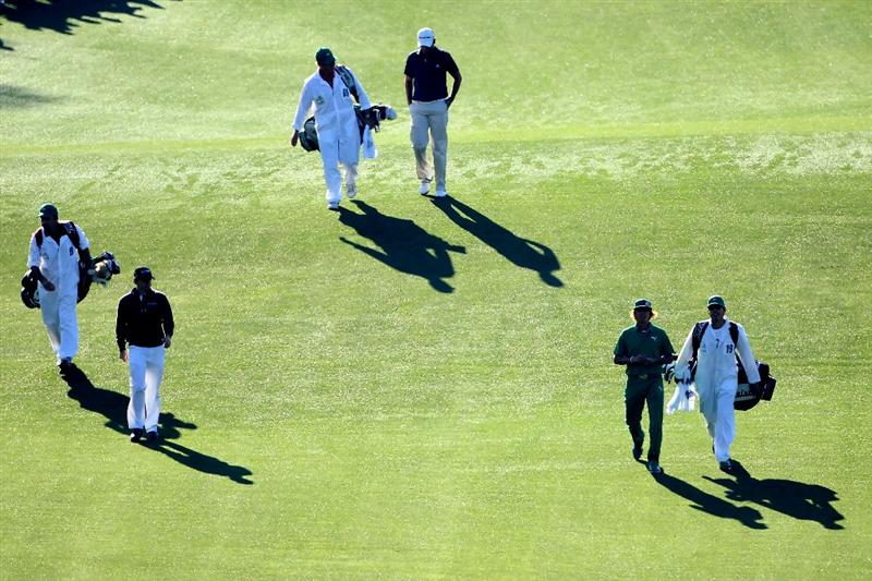 AUGUSTA, GA - APRIL 07:  Rory McIlroy of Northern Ireland (L), Jason Day of Australia (C) and Rickie Fowler walk with their caddies off the first tee during the first round of the 2011 Masters Tournament at Augusta National Golf Club on April 7, 2011 in Augusta, Georgia.  (Photo by Andrew Redington/Getty Images)