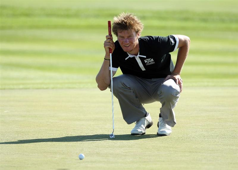 ASH, UNITED KINGDOM - MAY 31:  Chris Wood of England putts at the 16th hole during the final round of the 2009 European Open at the London Golf Club on May 31, 2009 in Ash, England.  (Photo by David Cannon/Getty Images)