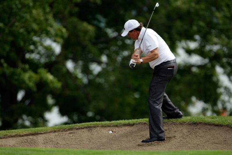 CHASKA, MN - AUGUST 15:  Phil Mickelson plays a shot from a fairway bunker on the tenth hole during the third round of the 91st PGA Championship at Hazeltine National Golf Club on August 15, 2009 in Chaska, Minnesota.  (Photo by Jamie Squire/Getty Images)