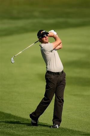 ASH, ENGLAND - MAY 29:  Scott Drummond of Scotland plays his second shot into the 18th green during the second round of The European Open at the London Golf Club on May 29, 2009 in Ash, England.  (Photo by Warren Little/Getty Images)