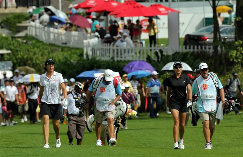 KUALA LUMPUR, MALAYSIA - OCTOBER 24:  Natalie Gulbis and Juli Inkster of USA leads the pack on the 1st hole during the Final Round of the Sime Darby LPGA on October 24, 2010 at the Kuala Lumpur Golf and Country Club in Kuala Lumpur, Malaysia. (Photo by Stanley Chou/Getty Images)