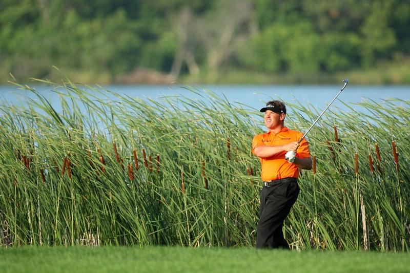 CHASKA, MN - AUGUST 14:  Lee Westwood of England plays a shot on the 16th hole during the second round of the 91st PGA Championship at Hazeltine National Golf Club on August 14, 2009 in Chaska, Minnesota.  (Photo by David Cannon/Getty Images)