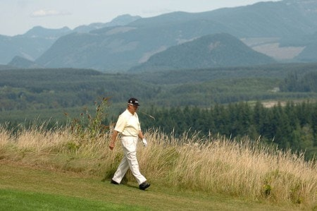J.C. Snead has a bite of wheatgrass as he walks down the 12th fairway during the first round of the 2005 Boeing Greater Seattle Classic at TPC Snoqualmie in Snoqualmie, Washington August 19, 2005.Photo by Steve Grayson/WireImage.com