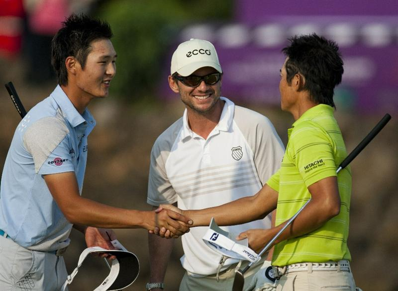 HAIKOU, CHINA - OCTOBER 30:  Golfer Danny Lee of New Zealand shakes hand with Golfer Ryuji Imada of Japan as Hollywood actor Christian Slater of USA smile during day four of the Mission Hills Start Trophy tournament at Mission Hills Resort on October 30, 2010 in Haikou, China. The Mission Hills Star Trophy is Asia's leading leisure liflestyle event which features Hollywood celebrities and international golf stars.  (Photo by Athit Perawongmetha/Getty Images for Mission Hills)