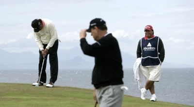 Eduardo Romero (ARG) putts as Loren Roberts (USA) looks on during the final round of the 2006 Senior British Open at the Westin Turnberry resort in Ayrshire, Scotland on July 30, 2006.Photo by Matthew Harris/WireImage.com