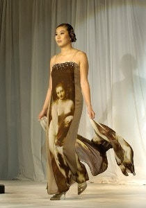 Shi Hyun Ahn models an Andre Kim gown on  the fashion runway  at the 2002 SBS Open at Turtle Bay February 14 at Kahuku, Hawaii.Photo by Al Messerschmidt/WireImage.com