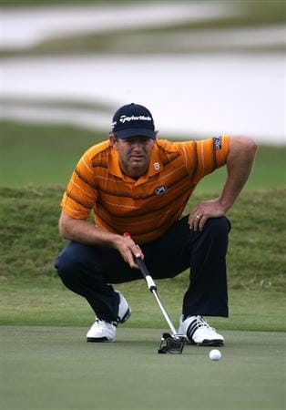 DORAL, FL - MARCH 11:  Retief Goosen of South Africa lines up a putt on the 11th hole during round one of the 2010 WGC-CA Championship at the TPC Blue Monster at Doral on March 11, 2010 in Doral, Florida.  (Photo by Marc Serota/Getty Images)