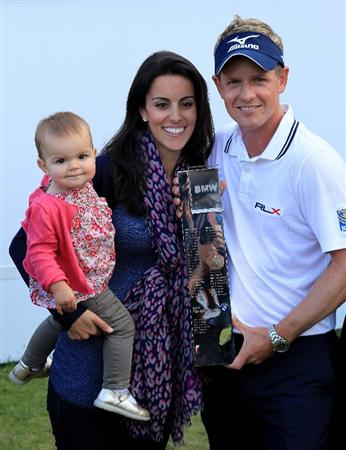 VIRGINIA WATER, ENGLAND - MAY 29:  Luke Donald of England holds the trophy with Wife Diane and Daughter Elle following his victory in a playoff on the 18th green, which also secured him the Number one World ranking during the final round of the BMW PGA Championship  at the Wentworth Club on May 29, 2011 in Virginia Water, England.  (Photo by David Cannon/Getty Images)
