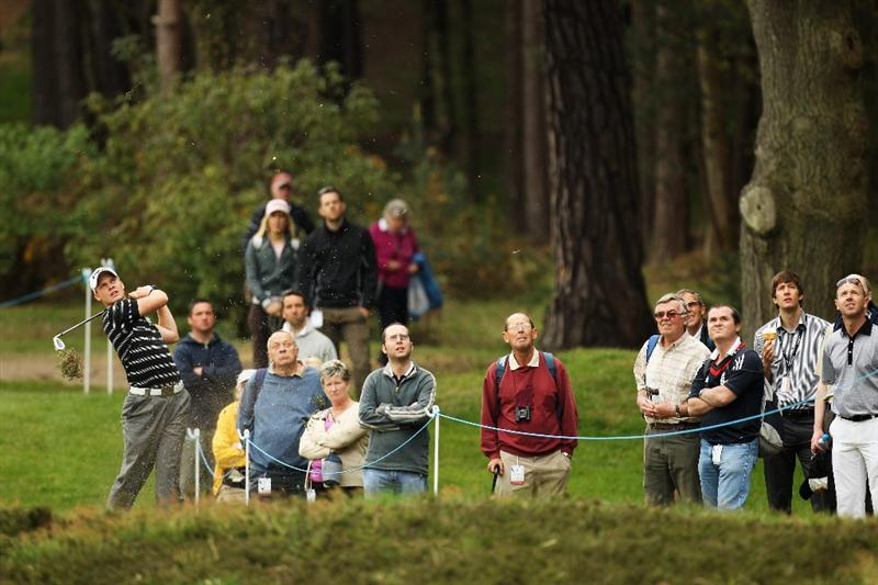 VIRGINIA WATER, ENGLAND - MAY 20:  Danny Willett of England plays his second shot on the 11th hole during the first round of the BMW PGA Championship on the West Course at Wentworth on May 20, 2010 in Virginia Water, England.  (Photo by Ross Kinnaird/Getty Images)