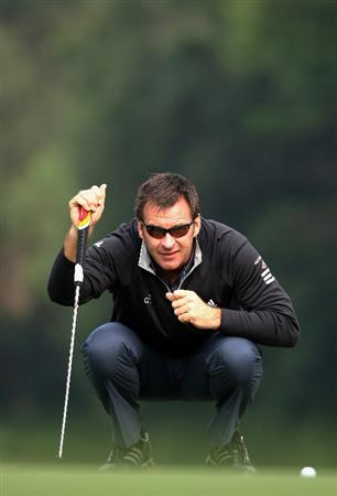HONG KONG, CHINA - NOVEMBER 19:  Nick Faldo of England ponders his putt during the pro - am of the UBS Hong Kong Open at the Hong Kong Golf Club on November 19, 2008 in Fanling, Hong Kong.  (Photo by Stuart Franklin/Getty Images)