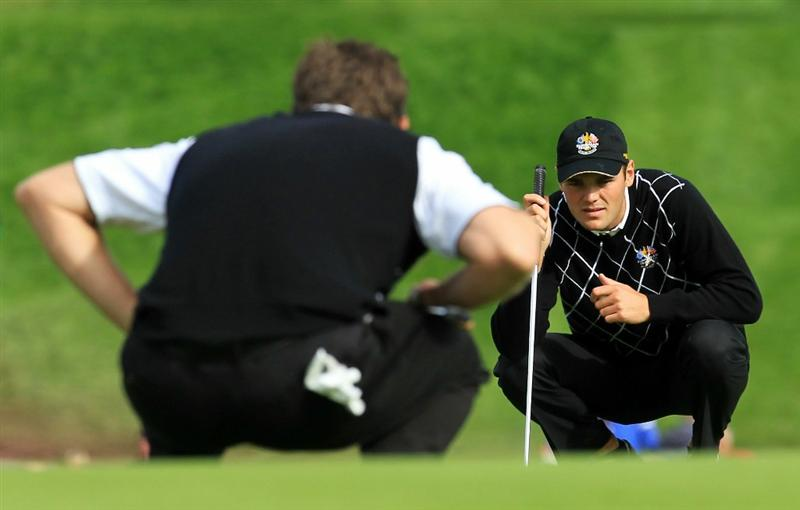 NEWPORT, WALES - OCTOBER 02:  Martin Kaymer of Europe lines up a putt during the rescheduled Afternoon Foursome Matches during the 2010 Ryder Cup at the Celtic Manor Resort on October 2, 2010 in Newport, Wales.  (Photo by David Cannon/Getty Images)