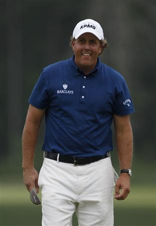 HUMBLE, TX - APRIL 03:  Phil Mickelson reacts to his missed eagle putt on the 12th hole during the final round of the Shell Houston Open at Redstone Golf Club on April 3, 2011 in Humble, Texas.  (Photo by Michael Cohen/Getty Images)