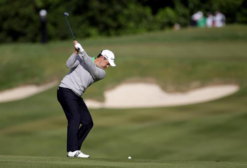 VIRGINIA WATER, ENGLAND - MAY 26:  Simon Khan of England plays his second shot on the first hole during the first round of the BMW PGA Championship at Wentworth Club on May 26, 2011 in Virginia Water, England.  (Photo by Ross Kinnaird/Getty Images)