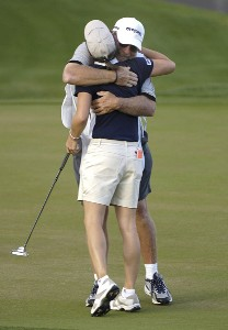 Aree Song gets a hug from her caddie after an eagle on the 18th hole during the third round of the 2006 Safeway International, Saturday, March 18, 2006 at Superstition Mountain Golf and Country Club in Superstition Mountain, ArizonaPhoto by Marc Feldman/WireImage.com