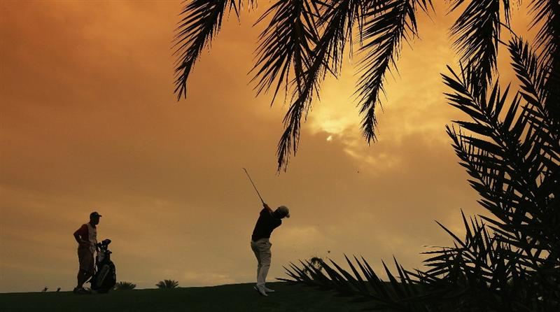 BAHRAIN, BAHRAIN - JANUARY 29:  Seung-yul Noh of South Korea plays his second shot at the 9th hole during the third round of the 2011 Volvo Champions held at the Royal Golf Club on January 29, 2011 in Bahrain, Bahrain.  (Photo by David Cannon/Getty Images)