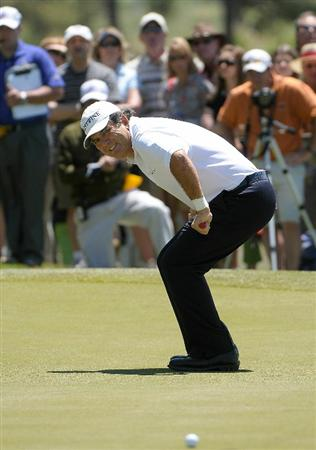 PARKER, CO. - MAY 30: David Frost of South Africa misses a birdie putt on the 10th hole  during the fourth and final round of the Senior PGA Championship at the Colorado Golf Club on May 30, 2010 in Parker, Colorado.  (Photo by Marc Feldman/Getty Images)
