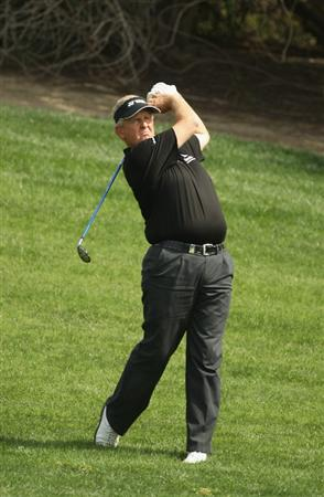 DUBAI, UNITED ARAB EMIRATES - FEBRUARY 11:  Colin Montgomerie of Scotland competes during the second round for the 2011 Omega Dubai desert Classic held on the Majilis Course at the Emirates Golf Club on February 11, 2011 in Dubai, United Arab Emirates.  (Photo by Ian Walton/Getty Images)