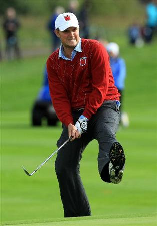 NEWPORT, WALES - OCTOBER 03:  Jeff Overton of the USA reacts to a near miss on the 11th green during the  Fourball & Foursome Matches during the 2010 Ryder Cup at the Celtic Manor Resort on October 3, 2010 in Newport, Wales.  (Photo by David Cannon/Getty Images)
