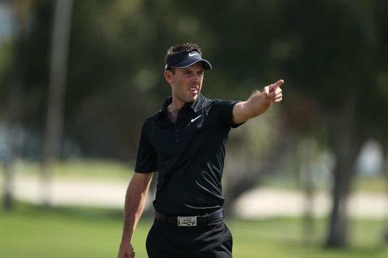 DORAL, FL - MARCH 14:  Charl Schwartzel of South Africa gestures on the second hole during the final round of the 2010 WGC-CA Championship at the TPC Blue Monster at Doral on March 14, 2010 in Doral, Florida.  (Photo by Scott Halleran/Getty Images)