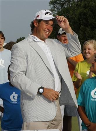 MEMPHIS, TN - JUNE 13: Lee Westwood of England celebrates as he puts on the winners jacket after winning St. Jude Classic at TPC Southwind held on June 13, 2010 in Memphis, Tennessee.  (Photo by John Sommers II/Getty Images)