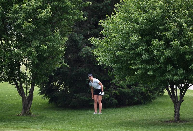 SPRINGFIELD, IL - JUNE 06:  Michelle Wie watches her third shot out of the first hole rough during the third round of the LPGA State Farm Classic golf tournament at Panther Creek Country Club on June 6, 2009 in Springfield, Illinois.  (Photo by Christian Petersen/Getty Images)
