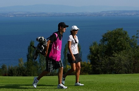 EVIAN, FRANCE - JULY 27:  Nikki Garrett of Australia walks with her caddie on the fifth hole during the second round of the Evian Masters on July 27, 2007 in Evian, France.  (Photo by Andrew Redington/Getty Images)