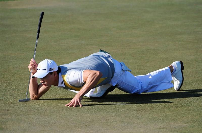 PALM BEACH GARDENS, FL - MARCH 07:  Camilo Villegas of Colombia looks over a putt on the 12th hole during the final round of the Honda Classic at PGA National Resort And Spa on March 7, 2010 in Palm Beach Gardens, Florida.  (Photo by Sam Greenwood/Getty Images)
