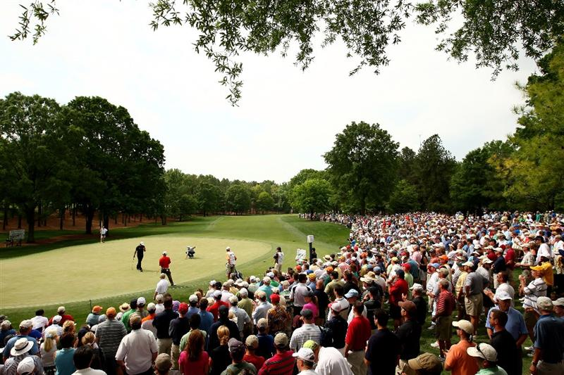 CHARLOTTE, NC - MAY 01:  The Group of Phil Mickelson, Anthony Kim and Davis Love III putts on the 3rd green during the second round of the Quail Hollow Championship at Quail Hollow Club on May 1, 2009 in Charlotte, North Carolina.  (Photo by Richard Heathcote/Getty Images)