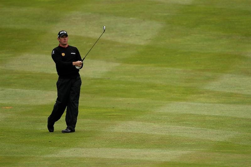 VIRGINIA WATER, ENGLAND - MAY 26:  Lee Westwood of England plays his second shot on the fourth hole during the first round of the BMW PGA Championship at Wentworth Club on May 26, 2011 in Virginia Water, England.  (Photo by Andrew Redington/Getty Images)