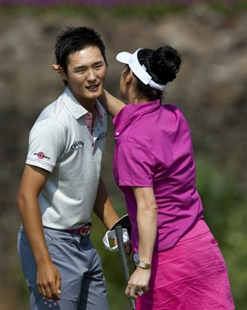 HAIKOU, CHINA - OCTOBER 29:  Golfer Danny Lee of New Zealand celebrates his putt with Hollywood actress Catherine Zeta-Jones during day three of the Mission Hills Start Trophy tournament at Mission Hills Resort on October 29, 2010 in Haikou, China. The Mission Hills Star Trophy is Asia's leading leisure liflestyle event which features Hollywood celebrities and international golf stars.  (Photo by Athit Perawongmetha/Getty Images for Mission Hills)