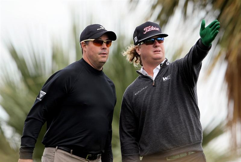 LA QUINTA, CA - JANUARY 20:  Greg Maddux (L) and Charley Hoffman discuss a tee shot on the 13th hole during the first round of the Bob Hope Classic at the Silver Rock Resort on January 20, 2010 in La Quinta, California.  (Photo by Jeff Gross/Getty Images)