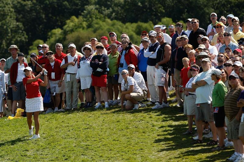 SUGAR GROVE, IL - AUGUST 23:  Cristie Kerr of the U.S. Team hits her second shot from the rough on the first hole during  the 2009 Solheim Cup at Rich Harvest Farms on August 23, 2009 in Sugar Grove, Illinois.  (Photo by Chris Graythen/Getty Images)