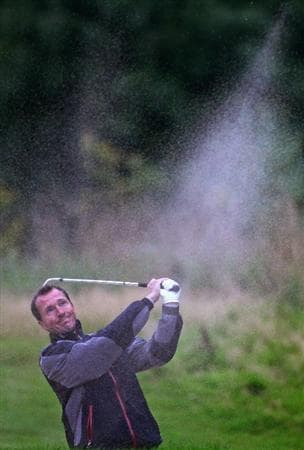 DUMBARTON, SCOTLAND - SEPTEMBER 18:  Jamie Harris of Great Britain plays out the bunker on the 12th green in the afternoon four ball matches at The Carrick on Loch Lomond on September 18, 2009 in Dumbarton, Scotland.  (Photo by Jeff J Mitchell/Getty Images)
